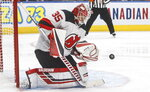 New Jersey Devils' goalie Cory Schneider (35) makes a save during the second period of an NHL hockey game against the New Jersey Devils on Friday, Nov. 8, 2019, in Edmonton, Alberta. (Jason Franson/The Canadian Press via AP)