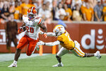 Bowling Green running back Jamal Johnson (20) gets past Tennessee defensive back Warren Burrell (4) during the first half of an NCAA college football game Thursday, Sept. 2, 2021, in Knoxville, Tenn. (AP Photo/Wade Payne)