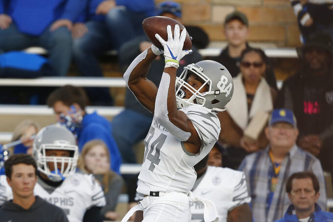 Memphis wide receiver Calvin Austin III (84) jumps up to catch a pass in the first half of an NCAA college football game against Tulsa in Tulsa, Okla., Saturday, Oct. 26, 2019. (AP Photo/Sue Ogrocki)