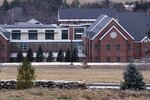 FILE - This Jan. 28, 2020, file photo shows the Sununu Youth Services Center in Manchester, N.H. Documents obtained by The Associated Press show a New Hampshire man now charged with holding down a teenage boy during a rape at the youth detention center had been fired years earlier. (AP Photo/Charles Krupa, File)