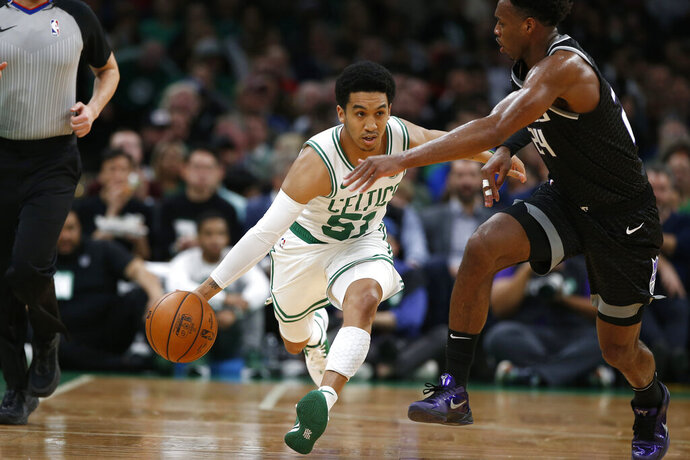 Boston Celtics' Tremont Waters, front left, brings the ball upcourt against Sacramento Kings' Buddy Hield, right, during the second quarter of an NBA basketball game Monday, Nov. 25, 2019, in Boston. (AP Photo/Winslow Townson)