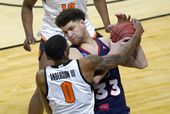Oklahoma State guard Avery Anderson III (0) pressures Liberty's Shiloh Robinson during the second half of a first round NCAA college basketball game Friday, March 19, 2021, at the Indiana Farmers Coliseum in Indianapolis.Oklahoma State won 69-60. (AP Photo/Charles Rex Arbogast)