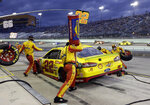 Joey Logano (22) makes a pit stop during the NASCAR Cup Series championship auto race at Homestead-Miami Speedway, Sunday, Nov. 18, 2018, in Homestead, Fla. (AP Photo/Lynne Sladky)