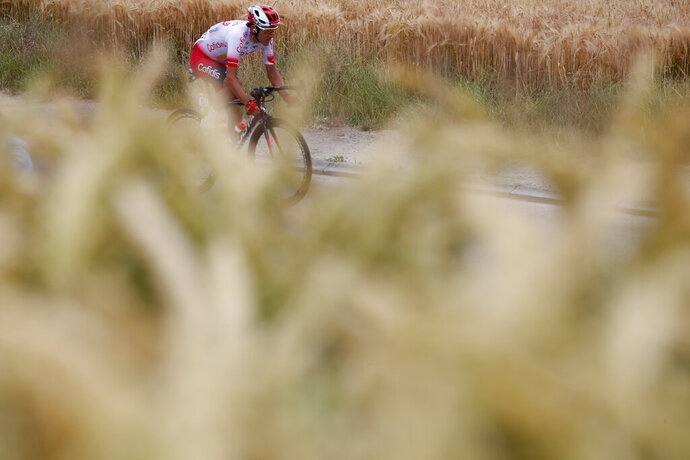 France's Stephane Rossetto rides during the first stage of the Tour de France cycling race over 194.5 kilometers (120,86 miles) with start in Brussels and finish in Brussels. Saturday, July 6, 2019. (AP Photo/Thibault Camus)