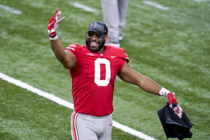 Ohio State defensive end Jonathon Cooper celebrates following the Big Ten championship NCAA college football game against Northwestern, Saturday, Dec. 19, 2020, in Indianapolis. Ohio State won 22-10. (AP Photo/Darron Cummings)