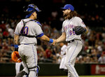 New York Mets relief pitcher Robert Gsellman (65) celebrates with catcher Wilson Ramos after a baseball game against the Arizona Diamondbacks, Friday, May 31, 2019, in Phoenix. The Mets won 5-4. (AP Photo/Matt York)