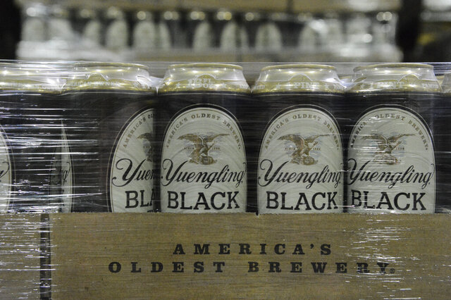 Yuengling Black and Tan cans are stacked in the warehouse of the D.G. Yuengling & Son Brewery Mill Creek plant on Tuesday, July 21, 2020. (Lindsey Shuey/Republican-Herald via AP)