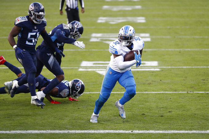 Detroit Lions running back D'Andre Swift score against the Tennessee Titans during the second half of an NFL football game Sunday, Dec. 20, 2020, in Nashville, Tenn. (AP Photo/Wade Payne)