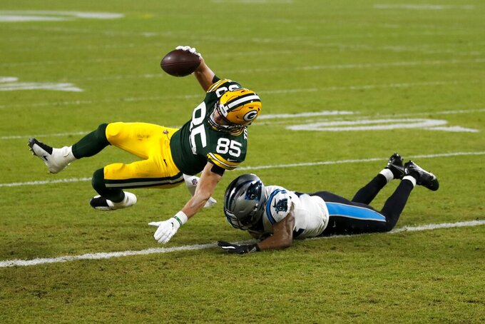 Green Bay Packers' Robert Tonyan gets past Carolina Panthers' Jeremy Chinn for a touchdown catch during the first half of an NFL football game Saturday, Dec. 19, 2020, in Green Bay, Wis. (AP Photo/Matt Ludtke)