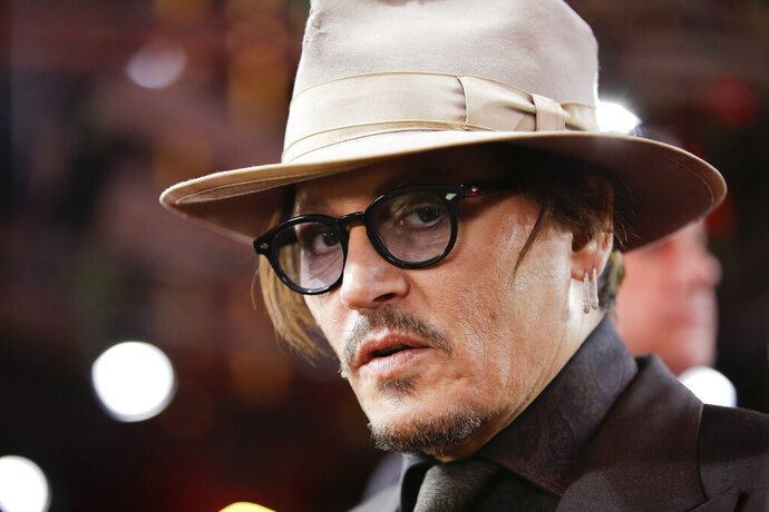 FILE - In this Friday, Feb. 21, 2020 file photo, actor Johnny Depp arrives for the screening of the film Minamata during the 70th International Film Festival Berlin, Berlinale in Berlin, Germany. Lawyers for British tabloid The Sun asked a judge on Thursday, June 25, 2020 to throw out Johnny Depp's libel claim against the paper because the film star allegedly failed to disclose evidence relating to his drug use. Depp is suing the newspaper's publisher News Group Newspapers and executive editor Dan Wootton over a 2018 article claiming he was violent and abusive to his ex-wife Amber Heard.(AP Photo/Markus Schreiber, File)