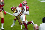 Washington Football Team wide receiver Cam Sims (89) is hit by San Francisco 49ers free safety Jimmie Ward (20) during the first half of an NFL football game, Sunday, Dec. 13, 2020, in Glendale, Ariz. (AP Photo/Ross D. Franklin)