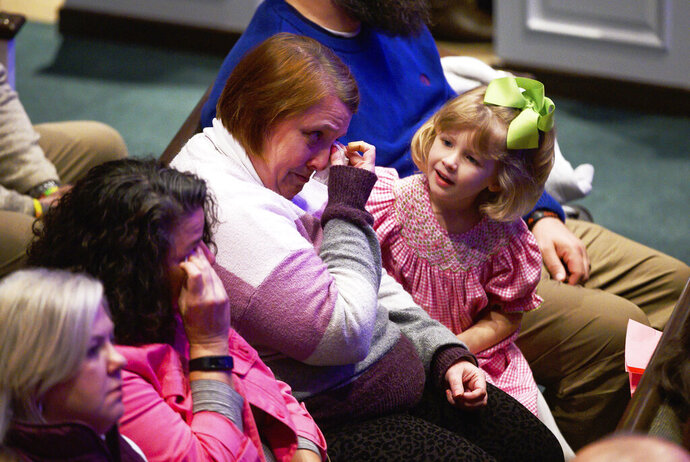 A woman wipes tears from her eyes during the remembrance service for six-year-old Faye Swetlik at Trinity Baptist Church in Cayce, S.C., Friday, Feb. 21, 2020. (Josh Morgan/The Greenville News via AP)