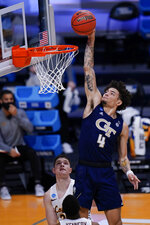 Georgia Tech guard Jordan Usher (4) dunks in front of Loyola Chicago guard Tate Hall in the first half of a college basketball game in the first round of the NCAA tournament at Hinkle Fieldhouse, Indianapolis, Friday, March 19, 2021. (AP Photo/AJ Mast)