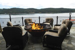 The balcony fire pit at this $27 million lakefront mansion in Coeur d'Alene is photographed on Wednesday,  June 23, 2021. The Spokane real estate market is booming. Spokane County's median home price in May 2021 reached another all-time high at $375,000. That was 29.5% greater than the $289,900 median in May 2020, according to the Spokane Association of Realtors.  (Kathy Plonka/The Spokesman-Review via AP)