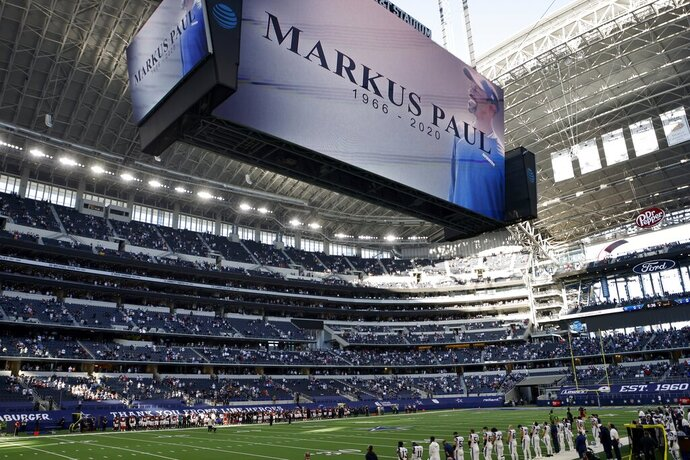 An image of Dallas Cowboys strength and conditioning coordinator Markus Paul is projected on the video screen as all in attendance observe a moment of silence before an NFL football game against the Washington Football Team in Arlington, Texas, Thursday, Nov. 26, 2020. Paul died on Wednesday. (AP Photo/Ron Jenkins)