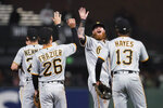 Pittsburgh Pirates' Ben Gamel, second from right, celebrates with Kevin Newman, left, Adam Frazier (26) and Ke'Bryan Hayes (13) after the Pirates defeated the San Francisco Giants 10-2 in a baseball game in San Francisco, Saturday, July 24, 2021. (AP Photo/Jeff Chiu)