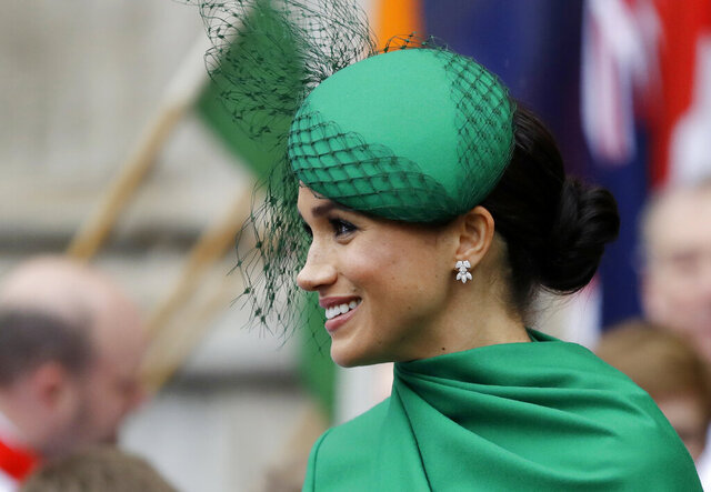 FILE - In this Monday, March 9, 2020 file photo, Britain's Meghan, the Duchess of Sussex leaves after attending the annual Commonwealth Day service at Westminster Abbey in London. A British judge on Wednesday Aug. 5, 2020, has ruled that the Duchess of Sussex can keep her friends' names secret while she brings a privacy-invasion lawsuit against a British newspaper. (AP Photo/Kirsty Wigglesworth, File)