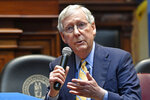 Senate Majority Leader Mitch McConnell, R-Ky., right, and former White House counsel Donald McGahn address the Kentucky chapters conference of The Federalist Society at the Kentucky State Capitol in Frankfort, Ky., Monday, Oct. 7, 2019. (AP Photo/Timothy D. Easley)