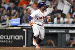 Houston Astros' Jose Altuve watches his RBI double during the sixth inning of the team's baseball game against the Cleveland Indians, Wednesday, July 21, 2021, in Houston. (AP Photo/Eric Christian Smith)