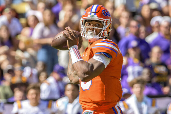 Florida quarterback Anthony Richardson (15) throws in the second half of an NCAA college football game against LSU in Baton Rouge, La., Saturday, Oct. 16, 2021. (AP Photo/Matthew Hinton)