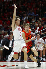 Oregon State guard Zach Reichle (11) drives to the basket as Utah guard Jaxon Brenchley (5) defends in the first half during an NCAA college basketball game Thursday, Jan. 2, 2020, in Salt Lake City. (AP Photo/Rick Bowmer)
