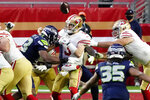 Seattle Seahawks defensive end Carlos Dunlap forces San Francisco 49ers quarterback C.J. Beathard (3) to fumble during the second half of an NFL football game, Sunday, Jan. 3, 2021, in Glendale, Ariz. (AP Photo/Rick Scuteri)