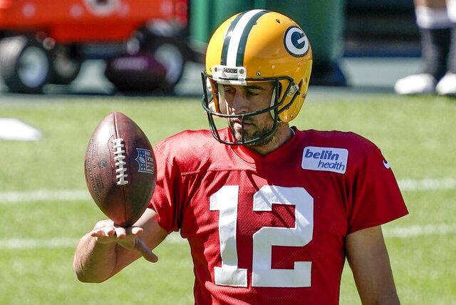 FILE - Green Bay Packers' Aaron Rodgers plays with a football during NFL football practice Friday, Sept. 4, 2020, in Green Bay, Wis. Aaron Rodgers will begin his 16th season with Green Bay looking  to continue his remarkable run of success against NFC North opponents as the Packers visit Minnesota. The Packers own a 47-18-1 record in games Rodgers has played against NFC North foes, including a 6-0 mark last season. (AP Photo/Morry Gash, File)
