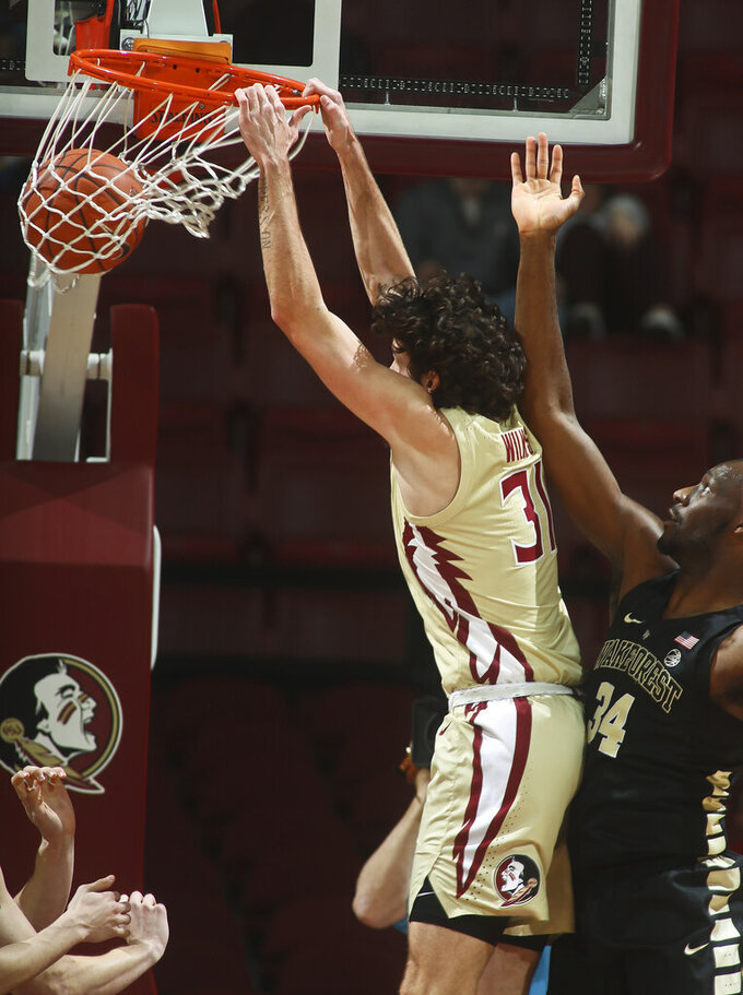 Florida State forward Wyatt Wilkes (31) dunks as Wake Forest forward Sunday Okeke (34) defends during the second half of an NCAA college basketball game in Tallahassee, Fla., Wednesday, Feb. 13, 2019. Florida State won 88-66. (AP Photo/Phil Sears)