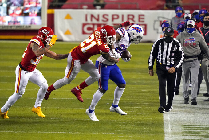 Buffalo Bills running back T.J. Yeldon is tackled by Kansas City Chiefs cornerback Bashaud Breeland (21) during the first half of the AFC championship NFL football game, Sunday, Jan. 24, 2021, in Kansas City, Mo. (AP Photo/Jeff Roberson)