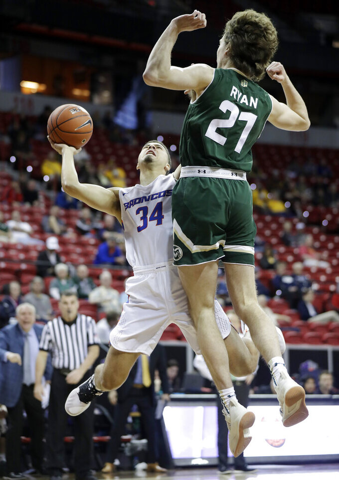 Colorado State's Logan Ryan (21) defends against a shot from Boise State's Alex Hobbs (34) during the first half of an NCAA college basketball game in the Mountain West Conference tournament, Wednesday, March 13, 2019, in Las Vegas. (AP Photo/Isaac Brekken)