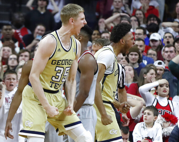 Georgia Tech's James Banks III, right and Kristian Sjolund (35) celebrate after Banks made a shot while being fouled with one second left in the team's NCAA college basketball game against North Carolina State in Raleigh, N.C., Wednesday, March, 6, 2019. (Ethan Human/The News & Observer via AP)