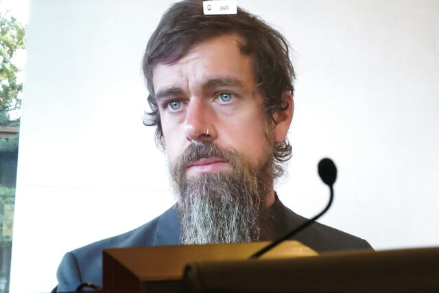 Twitter CEO Jack Dorsey appears on a screen as he speaks remotely during a hearing before the Senate Commerce Committee on Capitol Hill, Wednesday, Oct. 28, 2020, in Washington. The committee summoned the CEOs of Twitter, Facebook and Google to testify during the hearing. (Greg Nash/Pool via AP)