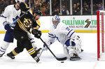 FILE - In this April 23, 2019, file photo, Boston Bruins left wing Brad Marchand, left, tries unsuccessfully to shoot past Toronto Maple Leafs goaltender Frederik Andersen (31) during the second period of Game 7 of an NHL hockey first-round playoff series, in Boston. With Tampa Bay, Boston, the Toronto Maple Leafs and refueled Florida Panthers, the Atlantic Division looks like murderer's row. The Bruins got through only after coming back from a 3-2 first-round deficit against Toronto and aren't feeling overly cocky because the same rocky road remains. (AP Photo/Charles Krupa, File)
