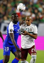 Haiti forward Frantzdy Pierrot (20) battles with Mexico defender Luis Rodriguez (21) for the ball during the first half of a CONCACAF Gold Cup soccer match Tuesday, July 2, 2019, in Glendale, Ariz. (AP Photo/Ross D. Franklin)