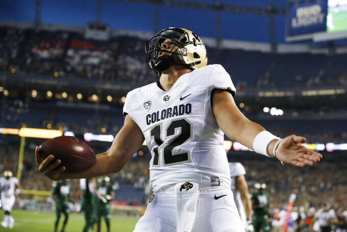 Colorado quarterback Steven Montez celebrates after his touchdown run against Colorado State in the first half of an NCAA college football game Friday, Aug. 31, 2018, in Denver. (AP Photo/David Zalubowski)