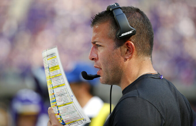 FILE - In this Sept. 23, 2018, file photo, Minnesota Vikings offensive coordinator John DeFilippo looks at his play sheet during the second half of an NFL football game against the Buffalo Bills, in Minneapolis. The Jacksonville Jaguars have hired former Minnesota offensive coordinator John DeFilippo to the same position. The Jaguars also filled five other staff positions. DeFilippo replaces Nathaniel Hackett, who was fired in late November and landed in Green Bay. (AP Photo/Bruce Kluckhohn, File)