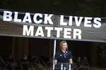 Clemson quarterback Trevor Lawrence speaks Saturday, June 13, 2020, in Clemson, S.C., during a protest over the death of George Floyd who died after being restrained by Minneapolis police officers on May 25. (AP Photo/John Bazemore)