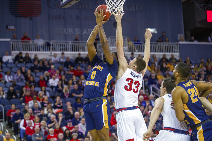 Murray State's Demond Robinson (0) goes up for a basket as Belmont's Nick Muszynski (33) tries to block his shot during the first half of an NCAA college basketball game for the championship of the Ohio Valley Conference men's tournament Saturday, March 7, 2020, in Evansville, Ind. (AP Photo/Daniel R. Patmore)