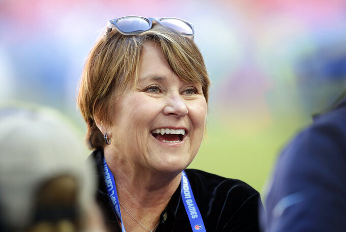 FILE- In this Oct. 21, 2018, file photo, Amy Adams Strunk, the controlling owner of the Tennessee Titans, smiles before an NFL football game against Los Angeles Chargers at Wembley stadium in London. Ownership of the Titans is remaining with the Adams family with Susie Adams Smith agreeing to sell her share of the team to KSA Industries Inc. Amy Adams Strunk will hold a 50% share with the other 50% held by Kenneth Adams IV, Barclay Adams and Susan Lewis who will continue as owners of the Titans with Adams Strunk continuing as controlling owner in a sale expected to be completed by the end of this year.  (AP Photo/Matt Dunham, File)