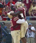 Florida State's Jacques Patrick is lifted by Baveon Johnson in celebration after scoring a touchdown in the second quarter of an NCAA college football game against Wake Forest, Saturday, Oct. 20, 2018 in Tallahassee, Fla. Florida State won 38-17. (AP Photo/Steve Cannon)