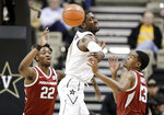 Vanderbilt forward Simisola Shittu (11) loses the ball between Arkansas defenders Gabe Osabuohien (22) and Mason Jones (13) in the first half of an NCAA college basketball game Wednesday, March 6, 2019, in Nashville, Tenn. (AP Photo/Mark Humphrey)