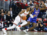 Ohio State's Luther Muhammad, left, drives to the basket against UMass-Lowell's Christian Lutete during the first half of an NCAA college basketball game Sunday, Nov. 10, 2019, in Columbus, Ohio. (AP Photo/Jay LaPrete)