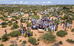FILE - in this Thursday, April 30, 2020 file photo, mourners gather for the burial of an elderly man suspected of dying from the new coronavirus, whose family requested not to be named, in Mogadishu, Somalia. Africa's coronavirus cases have surpassed 100,000, the Africa Centers for Disease Control and Prevention said Friday, May 22, 2020 as the continent with many fragile health systems has not yet seen the high numbers of other parts of the world. (AP Photo, File)