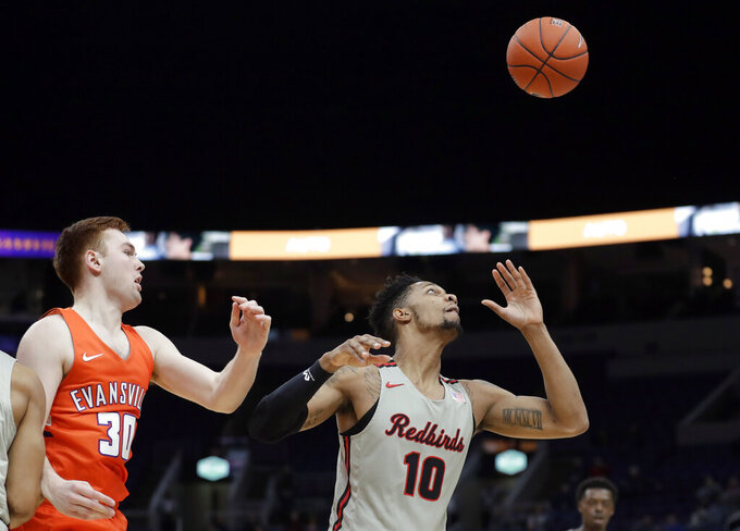 Illinois State's Phil Fayne (10) reaches for a rebound as Evansville's Noah Frederking (30) watches during the first half of an NCAA college basketball game in the first round of the Missouri Valley Conference men's tournament Thursday, March 7, 2019, in St. Louis. (AP Photo/Jeff Roberson)