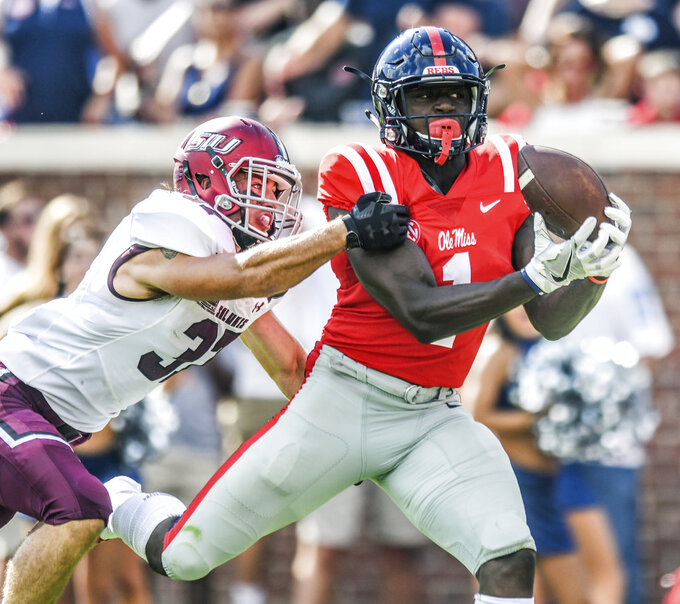 FILE - In this Sept. 8, 2018, file photo, Mississippi wide receiver A.J. Brown (1) scores on a 38-yard pass reception against Southern Illinois safety Michael Elbert (37) during an NCAA college football game at Vaught-Hemingway Stadium in Oxford, Miss. Brown is a unanimous first-team selection to The Associated Press All-Southeastern Conference team, announced Monday, Dec. 3, 2018. ( Bruce Newman/The Oxford Eagle via AP, File)