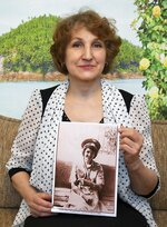 In this photo taken on Sunday, Feb. 10, 2019, Tatyana Rybalchenko, who worked as a nurse during the Soviet campaign in Afghanistan between 1986 and 1988, holds a photo of her taken in June 1986 in Kabul, Afghanistan, during her interview with The Associated Press in Moscow, Russia. In 1986, she was 33, working in a dead-end nursing job in Kiev, the capital of Soviet Ukraine, and was going through a breakup. One day, she joined a colleague who went to a military recruitment office and the recruiter asked Rybalchenko if she would like to work abroad, in Afghanistan. (AP Photo/Alexander Zemlianichenko)