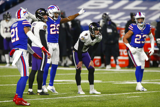 Buffalo Bills' Josh Norman (29) and Micah Hyde (23) watch as Baltimore Ravens kicker Justin Tucker (9) reacts after missing a field goal during the first half of an NFL divisional round football game Saturday, Jan. 16, 2021, in Orchard Park, N.Y. (AP Photo/John Munson)