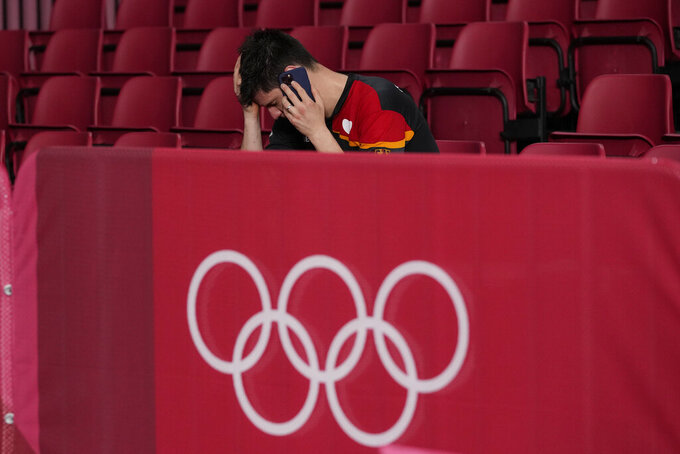 Germany's Dimitrij Ovtcharov reacts after losing the table tennis men's singles semifinal match against China's Ma Long at the 2020 Summer Olympics, Thursday, July 29, 2021, in Tokyo. (AP Photo/Kin Cheung)