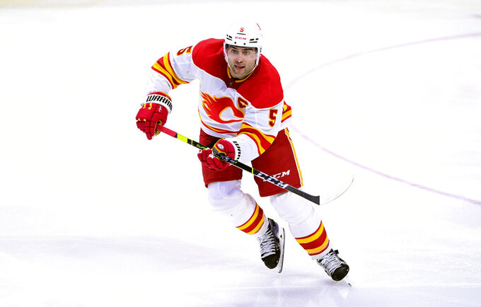 FILE - In this March 22, 2021 file photo, Calgary Flames captain Mark Giordano skates up the ice during the third period of an NHL hockey game against the Ottawa Senators in Ottawa, Ontario. Calgary exposed captain and 2019 Norris Trophy-winning defenseman Giordano.  The league released the protected lists of all 30 teams eligible for the expansion draft Sunday morning, July 18. (Sean Kilpatrick/The Canadian Press via AP, File)