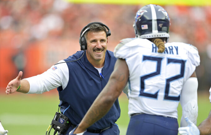 Tennessee Titans head coach Mike Vrabel, left, congratulates running back Derrick Henry after Henry scored a 1-yard touchdown during the first half in an NFL football game against the Cleveland Browns, Sunday, Sept. 8, 2019, in Cleveland. (AP Photo/David Richard)